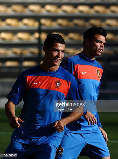 Cristiano Ronaldo of Portugal smiles flanked by his teammate Pepe during a training session, ahead of their 2010 World Cup Stage 2 Round of 16 match...