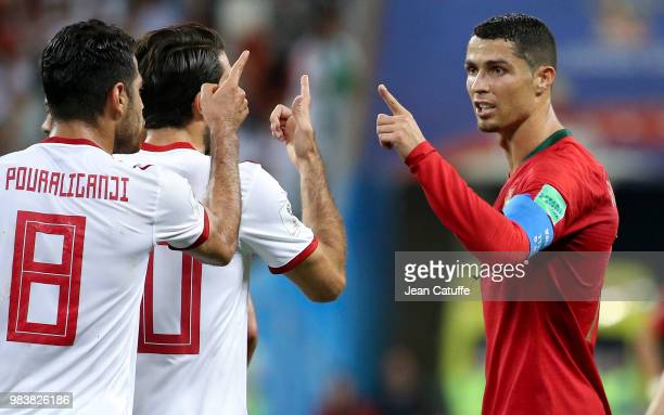 Cristiano Ronaldo of Portugal speaks his mind to Morteza Pouraliganji and Karim Ansarifard of Iran during the 2018 FIFA World Cup Russia group B...