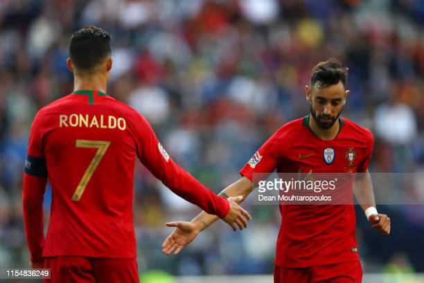 Cristiano Ronaldo of Portugal speaks with Bruno Fernandes of Portugal during the UEFA Nations League Final between Portugal and the Netherlands at...