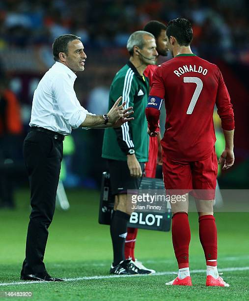 Cristiano Ronaldo of Portugal speaks with his coach Paulo Bento during the UEFA EURO 2012 group B match between Portugal and Netherlands at Metalist...