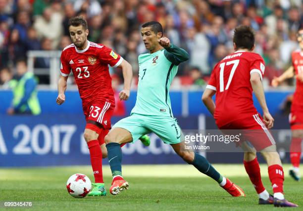 Cristiano Ronaldo of Portugal stretches for the ball during the FIFA Confederations Cup Russia 2017 Group A match between Russia and Portugal at...