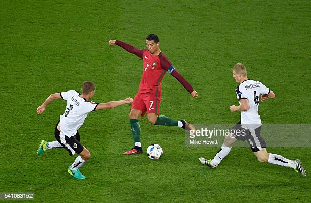Cristiano Ronaldo of Portugal takes a shot on goal during the UEFA EURO 2016 Group F match between Portugal and Austria at Parc des Princes on June...