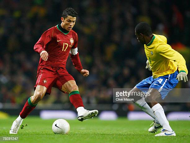Cristiano Ronaldo of Portugal takes on Juan of Brazil during the International friendly match between Brazil and Portugal at the Emirates Stadium on...