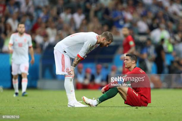 Cristiano Ronaldo of Portugal talks to Sergio Ramos of Spain during the 2018 FIFA World Cup Russia group B match between Portugal and Spain at Fisht...