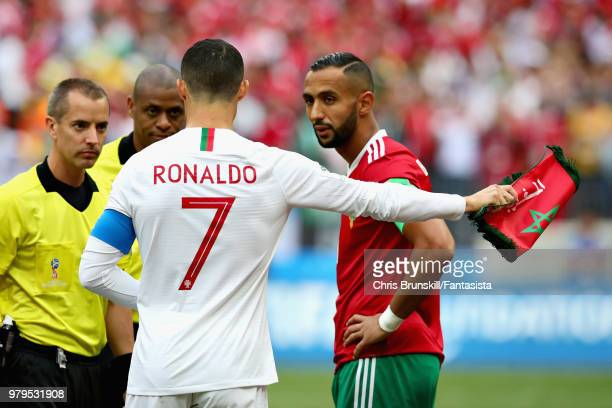 Cristiano Ronaldo of Portugal talks with Referee Mark Geiger and Mehdi Benatia of Morocco before the 2018 FIFA World Cup Russia group B match between...