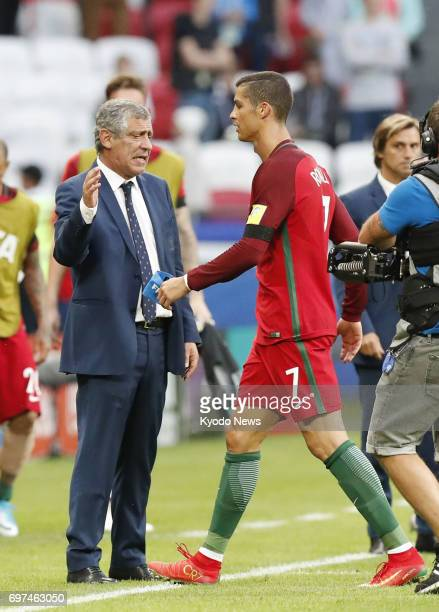 Cristiano Ronaldo of Portugal walks toward head coach Fernando Santos after ending a game in a 22 draw with Mexico in a Confederations Cup match in...