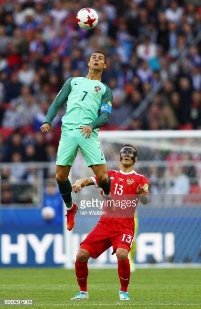 Cristiano Ronaldo of Portugal wins a header over Fedor Kudriashov of Russia during the FIFA Confederations Cup Russia 2017 Group A match between...