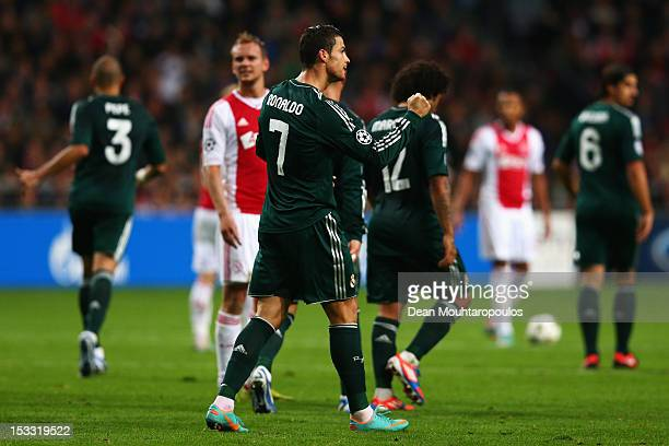 Cristiano Ronaldo of Real celebrates after he scores the third goal of the game during the UEFA Champions League Group D match between Ajax Amsterdam...