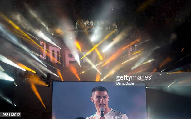 Cristiano Ronaldo of Real Madrid addresses fans during celebrations at the Santiago Bernabeu stadium following their victory last night in Kiev in...