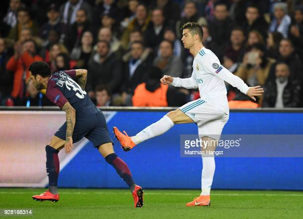 Cristiano Ronaldo of Real Madrid aims a kick at Dani Alves of PSG during the UEFA Champions League Round of 16 Second Leg match between Paris...