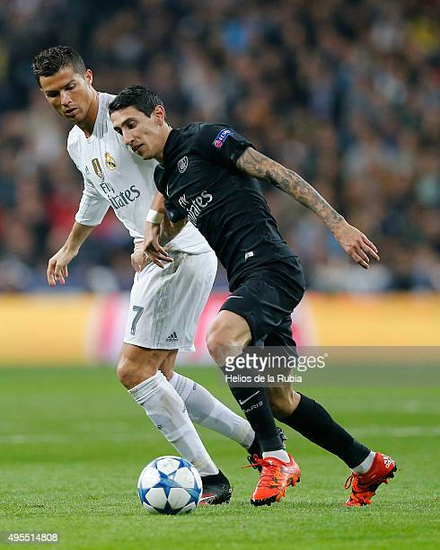 Cristiano Ronaldo of Real Madrid and Angel Di Maria of PSG compete for the ball during the UEFA Champions League Group A match between Real Madrid...