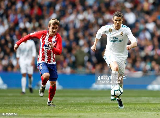 Cristiano Ronaldo of Real Madrid and Antoine Griezmann of Atletico de Madrid compete for the ball during the La Liga match between Real Madrid and...