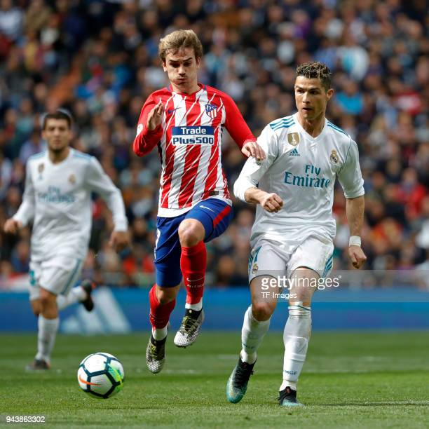 Cristiano Ronaldo of Real Madrid and Antoine Griezmann of Atletico Madrid battle for the ball during the La Liga match between Real Madrid and...
