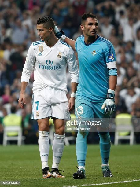 Cristiano Ronaldo of Real Madrid and Antonio Adan of Real Betis are seen during the Spanish La Liga match between Real Madrid and Real Betis at...