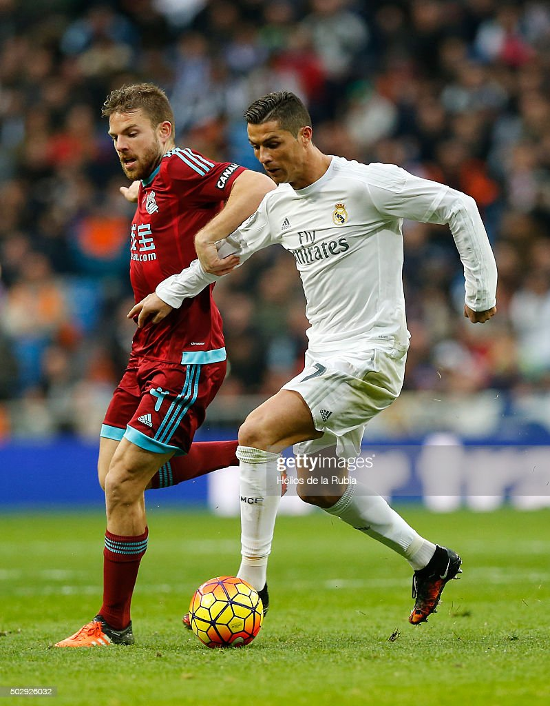 Cristiano Ronaldo of Real Madrid and Asier Illarramendi of Real Sociedad compete for the ball during the La Liga match between Real Madrid CF and Real Sociedad at Estadio Santiago Bernabeu on December 30, 2015 in Madrid, Spain.