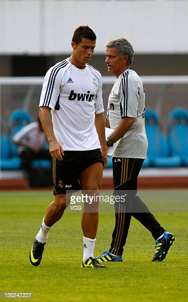 Cristiano Ronaldo of Real Madrid and coach Jose Mourinho in action during a training session at Tianhe Sports Center on August 1 2011 in Guangzhou...