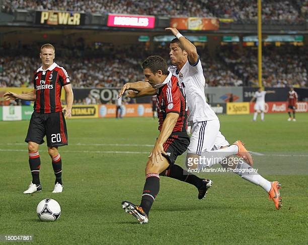 Cristiano Ronaldo of Real Madrid and Daniele Bonera of AC Milan battle for a loose ball at Yankee Stadium on August 8 2012 in New York City