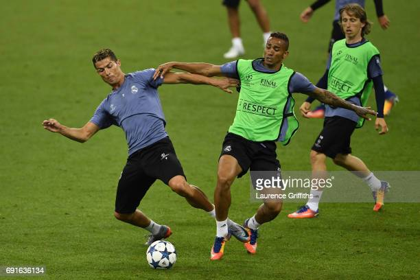 Cristiano Ronaldo of Real Madrid and Danilo of Real Madrid battle for possession during a Real Madrid training session prior to the UEFA Champions...