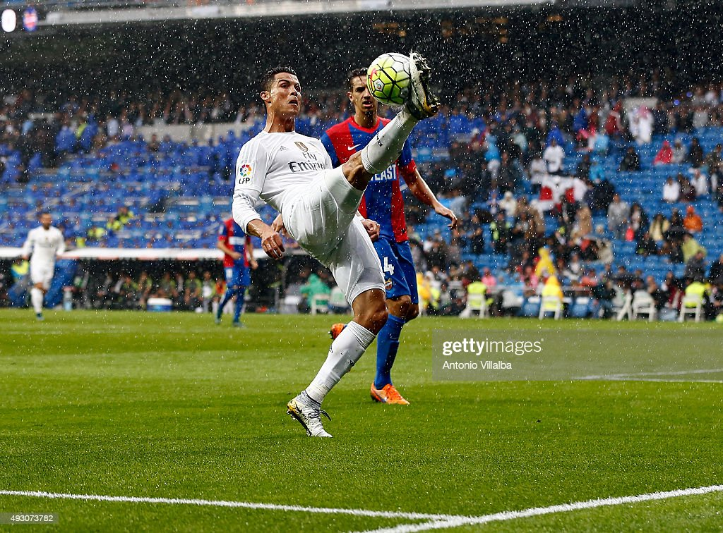 Cristiano Ronaldo (L) of Real Madrid and Feddal os Levante during the La Liga match between Real Madrid CF and Levante UD at Estadio Santiago Bernabeu on October 17, 2015 in Madrid, Spain.
