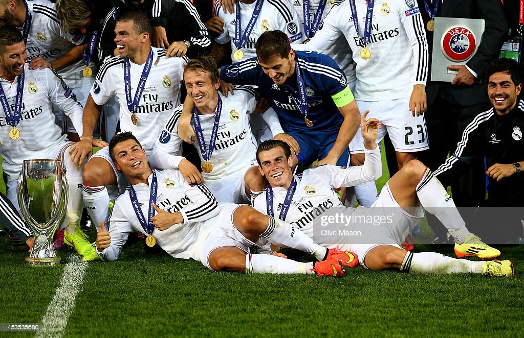 Cristiano Ronaldo of Real Madrid and Gareth Bale of Real Madrid celebrate with teammates following their team's 2-0 victory during the UEFA Super Cup between Real Madrid and Sevilla FC at Cardiff City Stadium on August 12, 2014 in Cardiff, Wales.