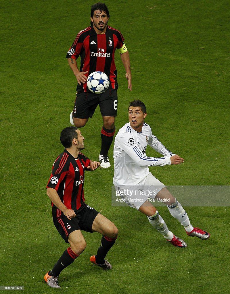 Cristiano Ronaldo (R) of Real Madrid and Gianluca Zambrotta (L) and Gennaro Gattuso (TOP) of Milan during the UEFA Champions League group G match between Real Madrid and AC Milan at the Estadio Santiago Bernabeu on October 19, 2010 in Madrid.