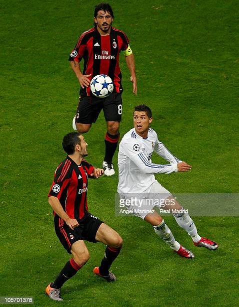 Cristiano Ronaldo of Real Madrid and Gianluca Zambrotta and Gennaro Gattuso of Milan during the UEFA Champions League group G match between Real...