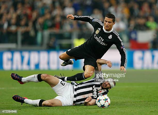 Cristiano Ronaldo of Real Madrid and Giorgio Chiellini of Juventus compete for the ball during the UEFA Champions League semi final football match...