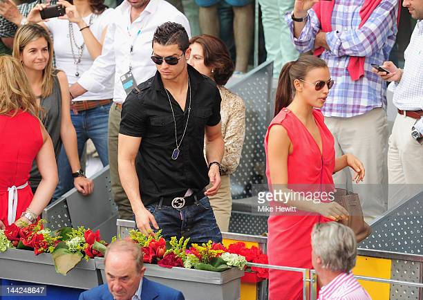 Cristiano Ronaldo of Real Madrid and girlfriend Irina Shayk on appear on centre court to watch Roger Federer on Day Eight of the Mutua Madrilena...