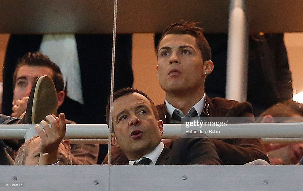 Cristiano Ronaldo of Real Madrid and his agent Jorge Mendes watch together from a box the UEFA Champions League Group B match between Real Madrid and Galatasaray AS at Estadio Santiago Bernabeu on November 27, 2013 in Madrid, Spain.