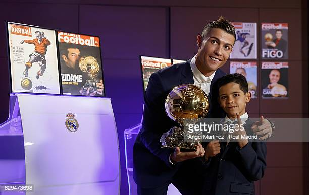 Cristiano Ronaldo of Real Madrid and his son Cristiano Ronaldo Jr pose with the Ballon D'Or 2016 trophy at Estadio Santiago Bernabeu on December 12...