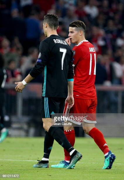 Cristiano Ronaldo of Real Madrid and James Rodriguez of Bayern Munich chat at half time during the UEFA Champions League Semi Final first leg match...