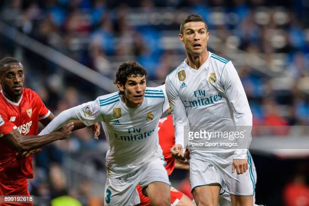Cristiano Ronaldo of Real Madrid and Jesus Vallejo of Real Madrid fights for position during La Liga 201718 match between Real Madrid and Sevilla FC...