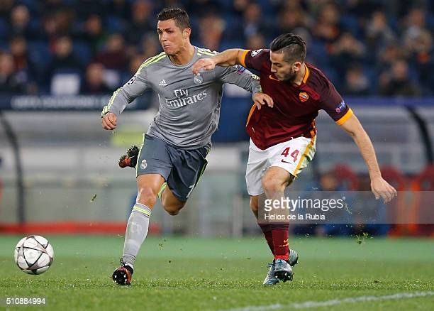 Cristiano Ronaldo of Real Madrid and Kostas Manolas of AS Roma compete for the ball during the UEFA Champions League Round of 16 First Leg match...