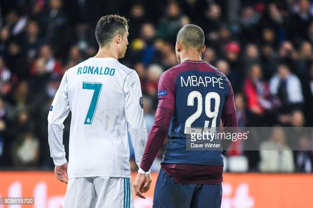 Cristiano Ronaldo of Real Madrid and Kylian Mbappe of PSG during the UEFA Champions League Round of 16 Second Leg match between Paris Saint Germain...