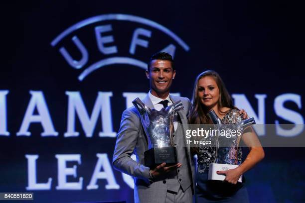 Cristiano Ronaldo of Real Madrid and Lieke Martens of Barcelona with the trophy of Best players in Europe during the UEFA Champions League Group...