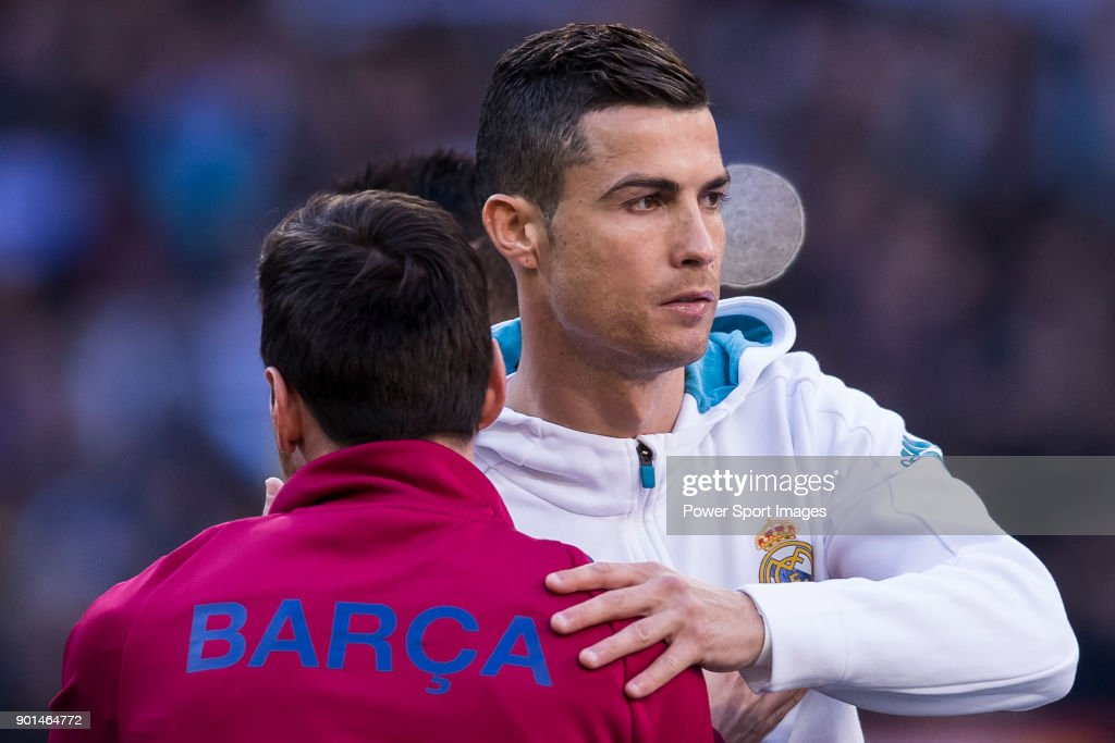 Cristiano Ronaldo of Real Madrid and Lionel Andres Messi of FC Barcelona hug each other prior to the La Liga 2017-18 match between Real Madrid and FC Barcelona at Santiago Bernabeu Stadium on December 23 2017 in Madrid, Spain.
