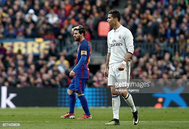 Cristiano Ronaldo of Real Madrid and Lionel Messi of Barcelona are seen during the La Liga football match between FC Barcelona and Real Madrid CF at...