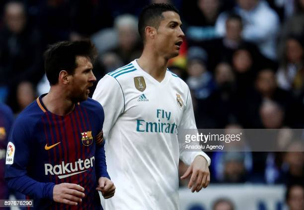 Cristiano Ronaldo of Real Madrid and Lionel Messi of Barcelona are seen during the La Liga match between Real Madrid and Barcelona at Santiago...