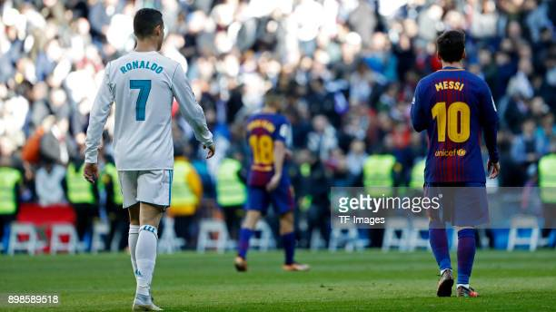 Cristiano Ronaldo of Real Madrid and Lionel Messi of Barcelona looks on during the La Liga match between Real Madrid and Barcelona at Estadio...