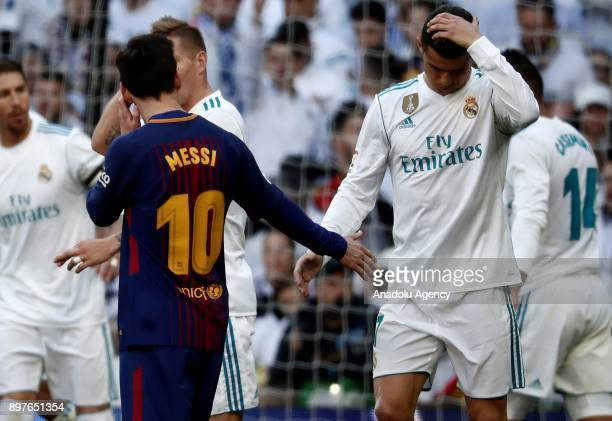 Cristiano Ronaldo of Real Madrid and Lionel Messi of Barcelona shake hands at the end of first half during the La Liga match between Real Madrid and...
