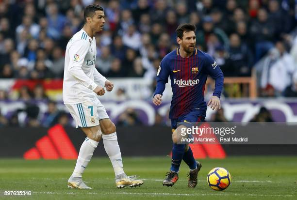Cristiano Ronaldo of Real Madrid and Lionel Messi of FC Barcelona in action during the La Liga match between Real Madrid and Barcelona at Estadio...