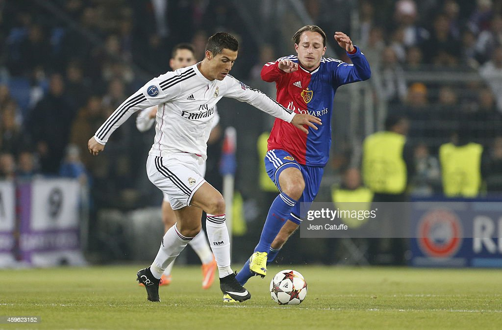 Cristiano Ronaldo of Real Madrid and Luca Zuffi of FC Basel in action during the UEFA Champions League Group B match between FC Basel 1893 and Real Madrid CF at St. Jakob-Park stadium on November 26, 2014 in Basel, Basel-Stadt, Switzerland.