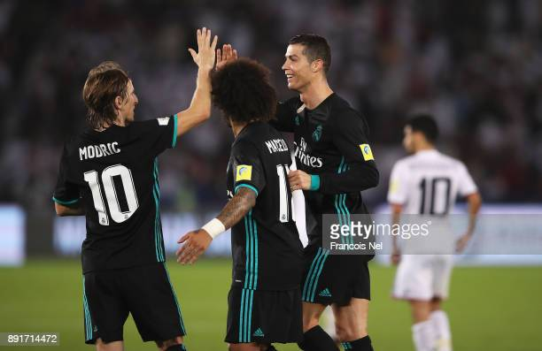Cristiano Ronaldo of Real Madrid and Luka Modric of Real Madrid celebrate together during the FIFA Club World Cup UAE 2017 semifinal match between Al...