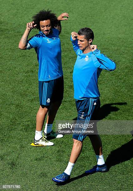 Cristiano Ronaldo of Real Madrid and Marcelo of Real Madrid stretch during a training session ahead of the UEFA Champions League Semi Final Second...