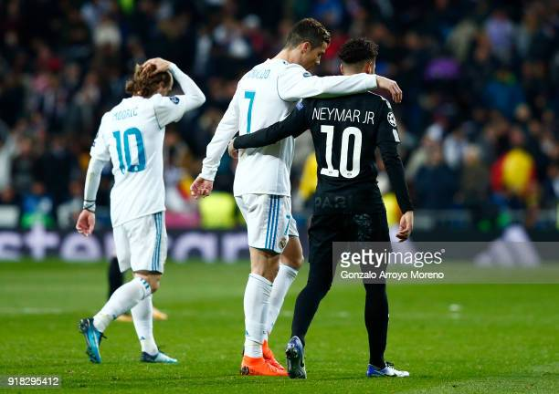 Cristiano Ronaldo of Real Madrid and Neymar of PSG embrace at half time during the UEFA Champions League Round of 16 First Leg match between Real...