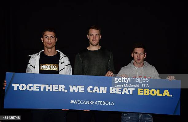 Cristiano Ronaldo of Real Madrid and Portugal Manuel Neuer of Bayern Munich and Germany Lionel Messi of Barcelona pose for a photograph with an anti...
