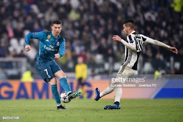 Cristiano Ronaldo of Real Madrid and Rodrigo Bentancur of Juventus in action during the UEFA Champions League Quarter Final Leg One match between...