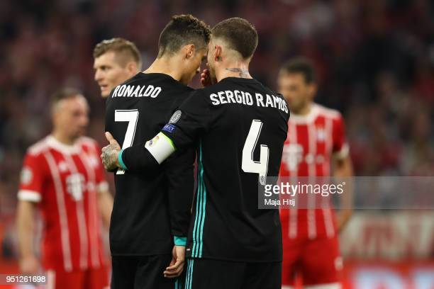 Cristiano Ronaldo of Real Madrid and Sergio Ramos of Real Madrid talk during the UEFA Champions League Semi Final First Leg match between Bayern...