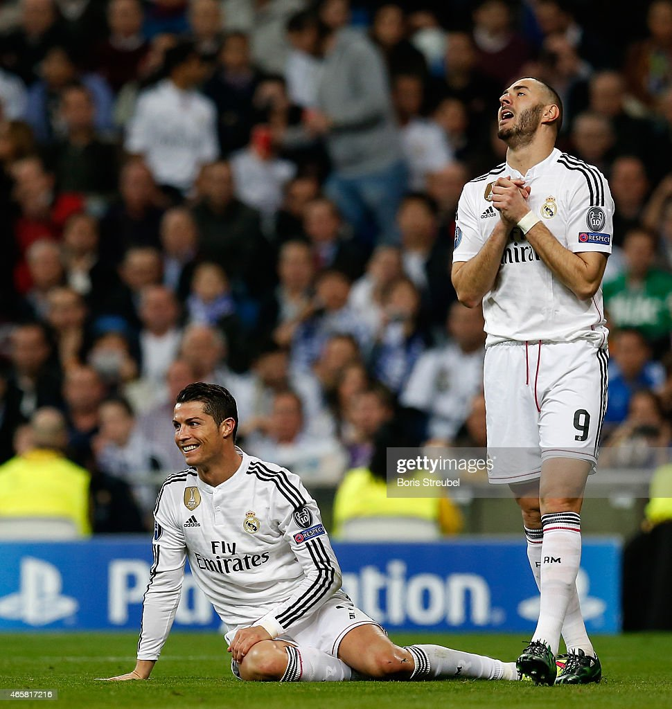 Cristiano Ronaldo (L) of Real Madrid and team mate Karim Benzema react during the UEFA Champions League Round of 16 second leg match between Real Madrid CF and FC Schalke 04 at Estadio Santiago Bernabeu on March 10, 2015 in Madrid, Spain.