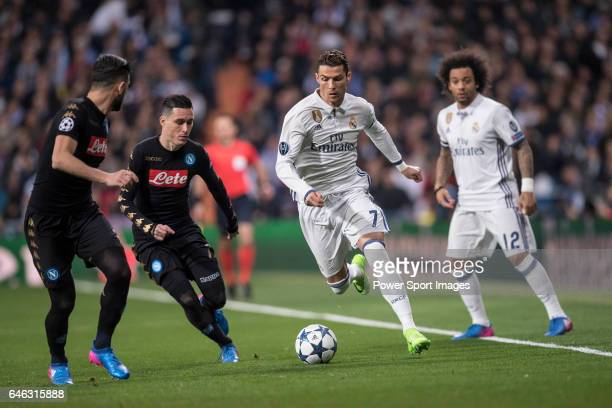 Cristiano Ronaldo of Real Madrid and teammate Marcelo Vieira Da Silva fight for the ball with Elseid Hysaj of SSC Napoli and teammate Jose Callejon...